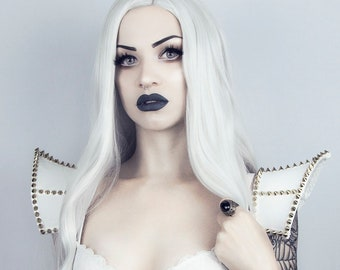 White gothic punk shoulder pads decorated with gold spikes