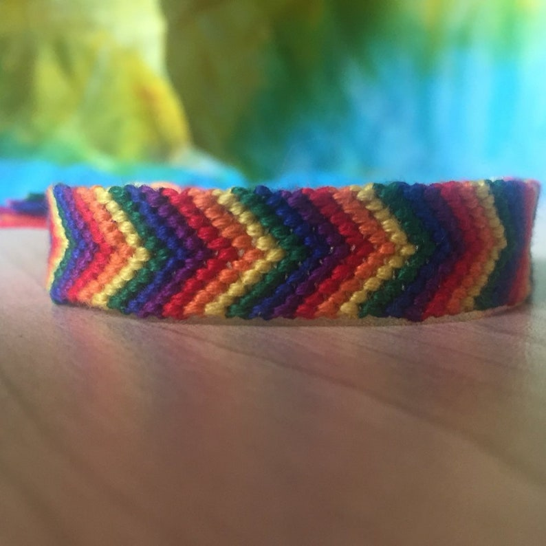 d29a9189805e3 Handmade Adjustable Rainbow Friendship Pride Woven Cotton Bracelet
