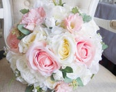 Elegant ivory and pale pink silk wedding bouquet.