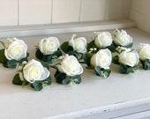 Ivory rose, gypsophila and eucalyptus silk wedding buttonhole.