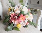 Coral and peach silk wedding bouquet.