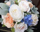 Natural ivory, blue and peach wedding bouquet.