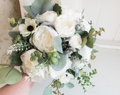 White silk wedding bouquet with eucalyptus.