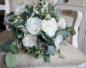 White and ivory silk wedding bouquet with eucalyptus greenery. Natural wedding bouquet