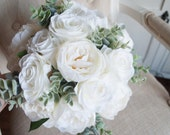 Luxury ivory rose and peony wedding bouquet. Winter wedding bouquet. Eucalyptus bouquet