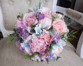 Pastel pink silk wedding bouquet.