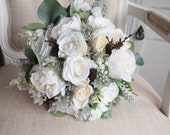Winter wedding silk wedding bouquet. Rose and peony bouquet with pine cones and eucalyptus
