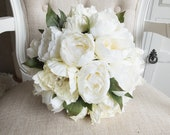 Ivory and cream peony wedding bouquet with greenery.