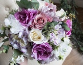 Purple and lilac silk wedding bouquet.