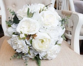 Ivory and white silk wedding bouquet. Made with artificial roses, peonies, hydrangea, garden style roses and mixed greenery