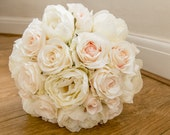 Luxury blush pink and ivory silk wedding bouquet.