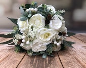 Winter silk wedding bouquet of roses and peonies.