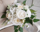 Rustic ivory and white silk wedding bouquet. Natural rose and hydrangea bouquet with trailing greenery.