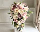 Luxury dusky pink and cream roses silk wedding bouquet.