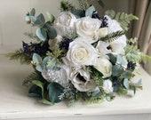 White and navy blue silk wedding bouquet. Winter wedding flowers
