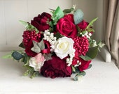 Red and white silk wedding bouquet.