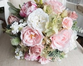 Dusky pink and ivory silk wedding bouquet.