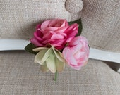 Pink silk wedding buttonhole / boutonniere.