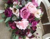 Pink and plum trailing teardrop wedding bouquet.