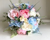 Pink, pale blue and ivory silk wedding bouquet. Peonies, roses and hydrangea.