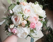 Blush pink and pale peach silk wedding bouquet.