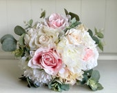Pale pink, blush and ivory wedding bouquet with eucalyptus greenery.