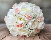 Pale pink and ivory silk wedding bouquet. Peonies, roses and gypsophila.