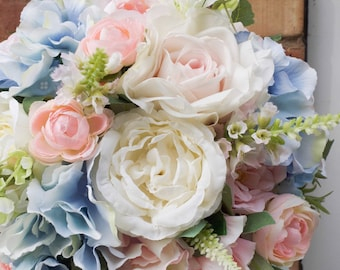 Pastel wedding bouquet in pale blue, blush pink and ivory. Made with artificial roses, peonies, stocks and hydrangea.