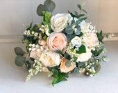 Ivory and peach silk wedding bouquet