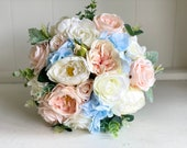 Elegant blush peach, light blue and ivory silk wedding bouquet.
