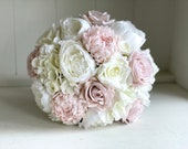 Light dusty pink and white silk wedding bouquet.