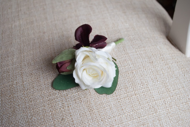 Burgundy and ivory cluster silk wedding buttonhole / image 0