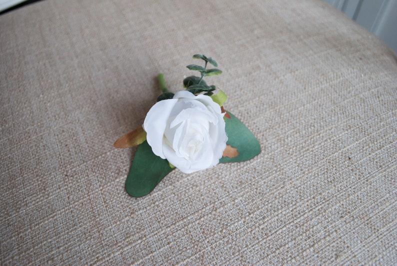 White rose and eucalyptus silk wedding buttonhole / image 0