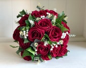 Red roses and gypsophila with eucalyptus and ivy silk wedding bouquet.