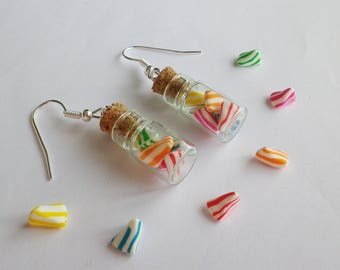 vial with white and multi-colored cherry candy earrings