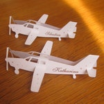 40 brand-place airplanes in cut paper, to katharina's attention