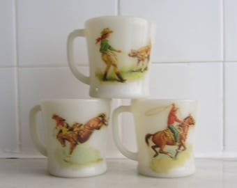 FIRE-KING by Anchor Hocking - Set of three D-handle ivory Coffee Mugs decorated with vintage Western illustrations - Made in USA - 1940s