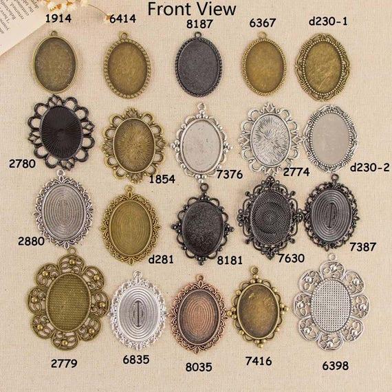 6 Fassungen in gunmetal für 10 x 14 Cabochons