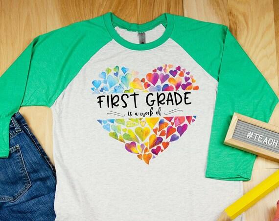 A Work of Heart Teacher Valentine's Day Tshirt | Super-soft 3/4 Sleeve Raglan T-shirt | Elementary Teacher | Cute Holiday Shirt