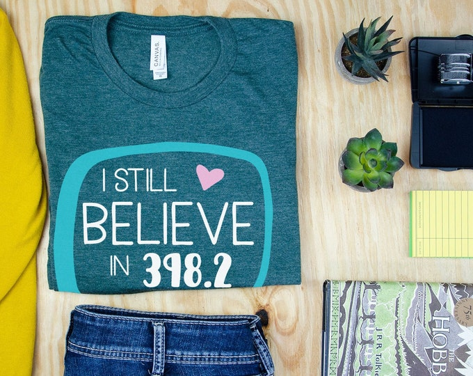 I Still Believe in 398.2 - Librarian T-shirt | Super-Soft, Vintage-Feel Tshirt | Reading | Libraries | Dewey Decimal | Library Science