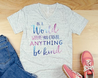 In a World Where You Can Be ANYTHING be KIND Teacher Unisex V-Neck Short Sleeve T-shirt | Vintage-Feel & Super-Soft | Teaching Tshirt