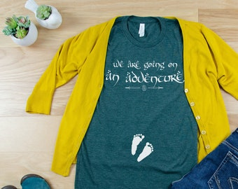 "Lord of the Rings inspired Pregnancy Announcement Tshirt | We're Going on an Adventure with Baby Footprints for the tiniest of ""Hobbitses"""