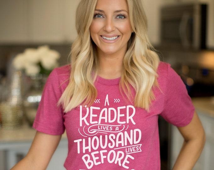 A Reader Lives a Thousand Lives Librarian & Reading Unisex Short Sleeve T-shirt | Books | Bookish