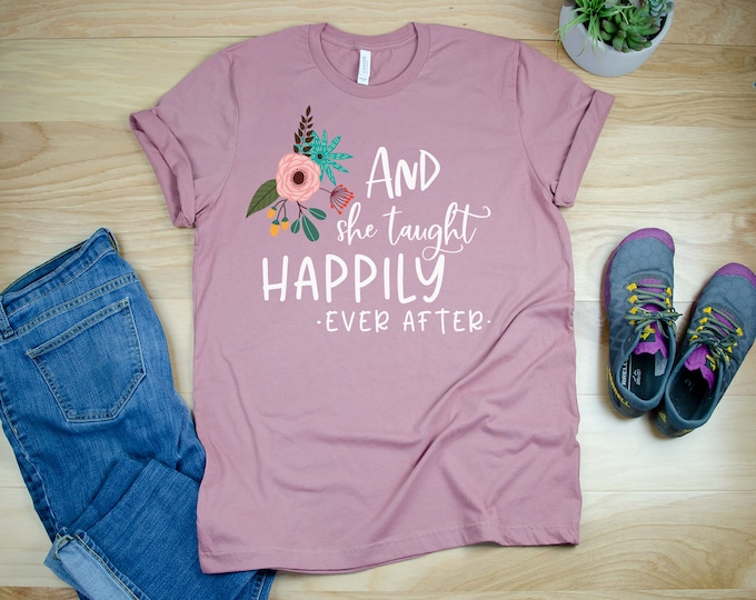 Teacher Shirt with And she Taught Happily Ever After Design Unisex Teacher Tshirt | Graduation Gift | First Grade Teacher