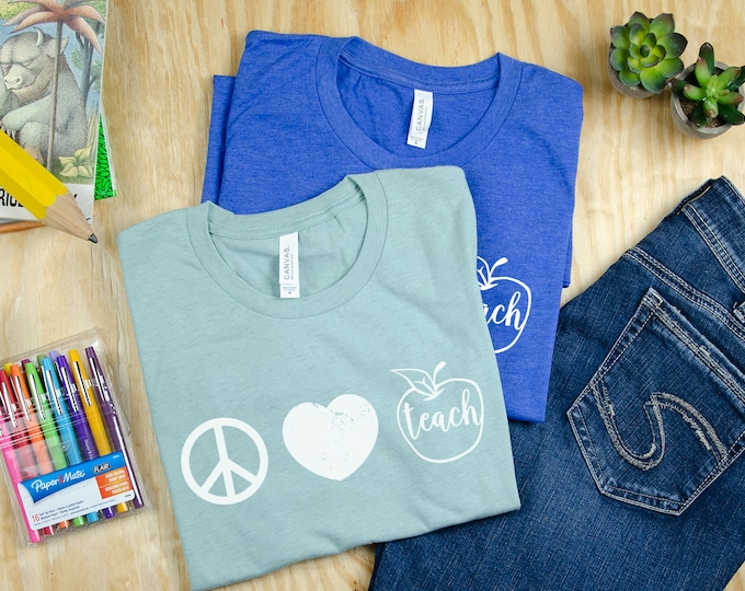 Featured listing image: Vintage Peace, Love, and Teach Teacher T-shirt | Elementary Teacher Shirt | Super-Soft with Distressed Print | Apple Teacher