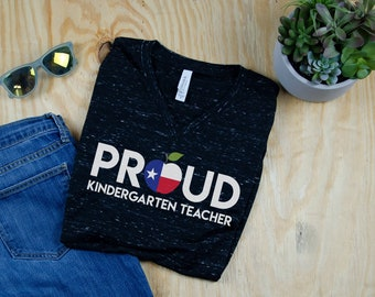 "Proud to Be a ""Any Grade"" Level Apple Flag Teacher Unisex V-Neck Short Sleeve T-shirt | Vintage-Feel & Super-Soft | First Grade Kindergarten"