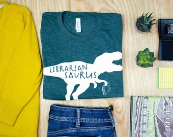 Librarian Saurus Dinosaur Librarian & Reading T-shirt | Bookish Tshirt | Reading Dinosaur T-Rex and Triceratops