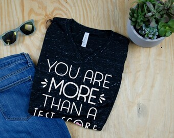 You are More than a Test Score Unisex V-Neck Short Sleeve Teacher T-shirt | Vintage-Feel & Super-Soft | Modern | Testing Tshirt for School