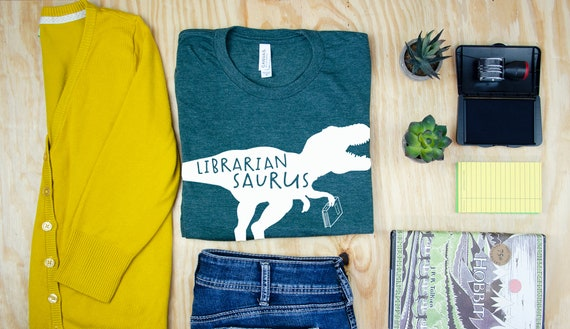 Librarian Saurus Dinosaur Librarian & Reading T-shirt | Bookish Tshirt | Reading Dinosaur T-Rex and Triceratops
