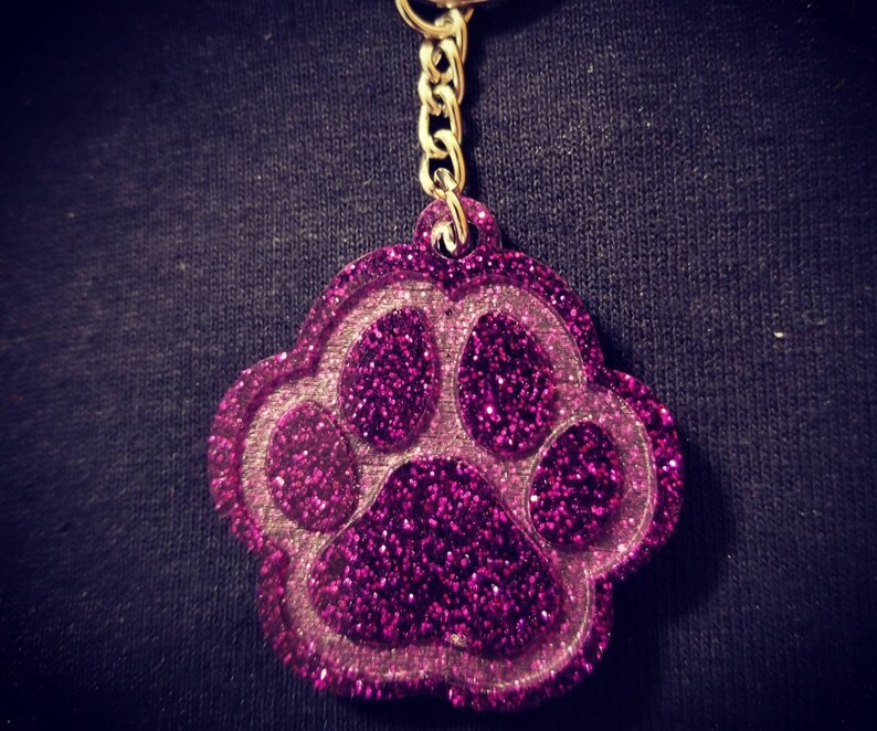 Carry the love for your pet with your keys! Glitter Paw Keychain Many color options